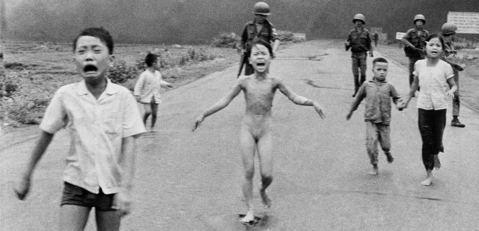 FILE - In this June 8, 1972 file photo, South Vietnamese forces follow after terrified children, including 9-year-old Kim Phuc, center, as they run down Route 1 near Trang Bang after an aerial napalm attack on suspected Viet Cong hiding places. A South Vietnamese plane accidentally dropped its flaming napalm on South Vietnamese troops and civilians. The terrified girl had ripped off her burning clothes while fleeing. The children from left to right are: Phan Thanh Tam, younger brother of Kim Phuc, who lost an eye, Phan Thanh Phouc, youngest brother of Kim Phuc, Kim Phuc, and Kim's cousins Ho Van Bon, and Ho Thi Ting. Behind them are soldiers of the Vietnam Army 25th Division. (AP Photo/Nick Ut, File)/NYDG105/431676074992/JUNE 8 1972 FILE PHOTO/1509032341