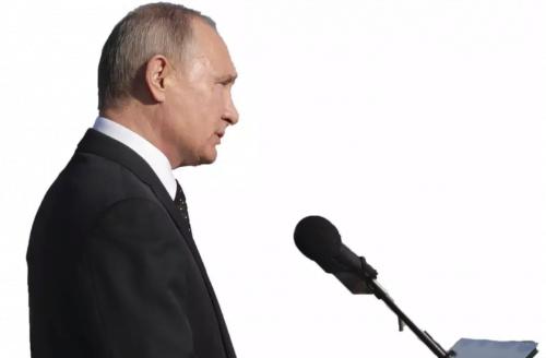 Le président russe Vladimir Poutine s'adresse aux militaires alors qu'il visite la base aérienne de Hmeymim dans la province de Lattaquié, en Syrie. (Crédit photo: MIKHAIL KLIMENTYEV / SPUTNIK / REUTERS)