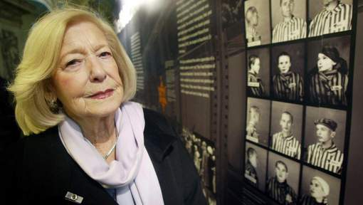 """FILE  - In this Jan. 27, 2004 file photo, Holcaust survivor Gena Turgel poses for a photo, in London. Turgel, a Holocaust survivor who comforted diarist Anne Frank at the Bergen-Belsen concentration camp months before its liberation, has died. She was 95. Britain's chief rabbi, Ephraim Mirvis, said Turgel died Thursday, June 7, 2018. Turgel had been in two other camps before she met Anne Frank in a hospital at Bergen-Belsen where the teenager was dying from typhus. After World War II, Turgel married one of the camp's British liberators, Norman Turgel, earning the nickname """"The Bride of Belsen."""" (Paul Faith/PA via AP, File)"""