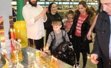 Lighting Hanukkah candles at JFK International Airport with Chabad