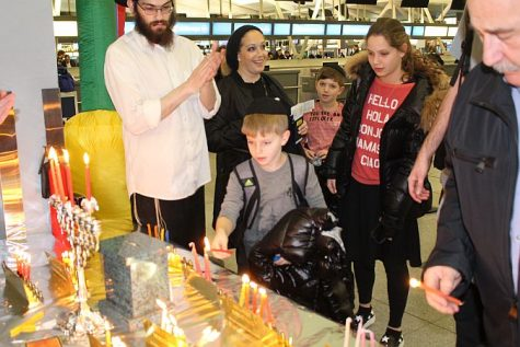 Lighting Hanukkah candles at JFK International Airport with Chabad