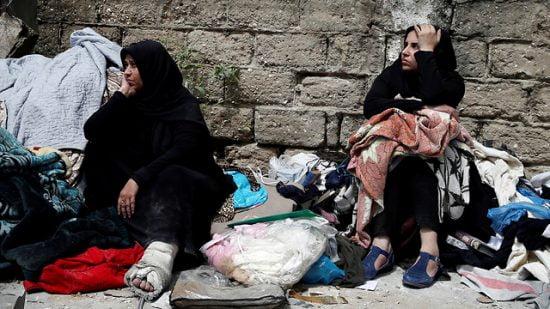 Des habitants de Gaza lors d'un raid aérien israélien (Photo: Reuters)