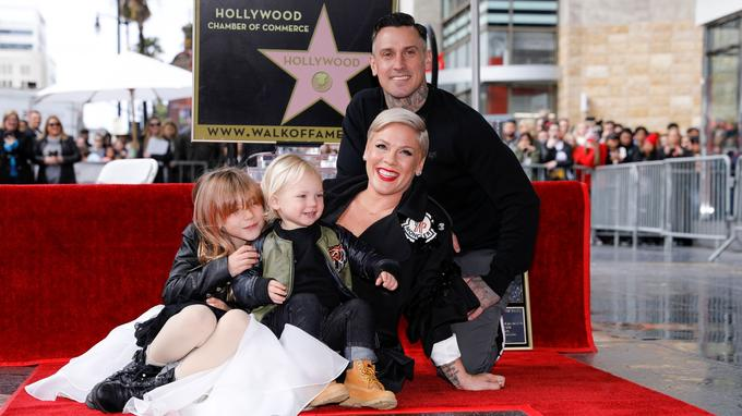 Singer and songwriter Pink poses for a picture with her husband Carey Hart and two kids Willow and Jameson as she receives a star on the Hollywood Walk of Fame in Los Angeles, California, U.S., February 5, 2019.    REUTERS/Mike Blake - RC116762B900