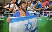RIO DE JANEIRO, BRAZIL - AUGUST 12: Or Sasson of Israel celebrate his victory with fans after the bronze final men's +100kgs at Carioca Arena 2 on August 12, 2016 in Rio de Janeiro, Brazil. (Photo by Xavier Laine/Getty Images)