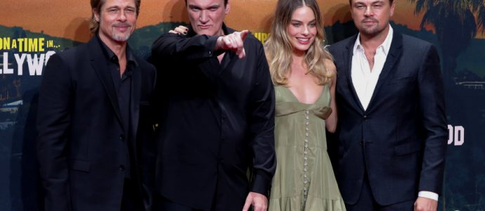 """Director Quentin Tarantino and cast members Brad Pitt, Leonardio di Caprio and Margot Robbie pose as they arrive for the Berlin premiere of """"Once Upon a Time in Hollywood"""",in Berlin, Germany. (photo credit: REUTERS/FABRIZIO BENSCH)"""