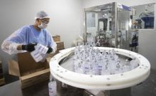 A worker produces hand sanitizer at the Companhia Nacional do Álcool (CNA) factory in Piracicaba, Brazil, Tuesday, March 3, 2020. Last week the factory added a second shift of workers to produce more hand sanitizer, and while the CNA was never an exporter, it's considering that by adding a third shift. One week ago, Brazil confirmed Latin America's first case of the new coronavirus. (AP Photo/Andre Penner)
